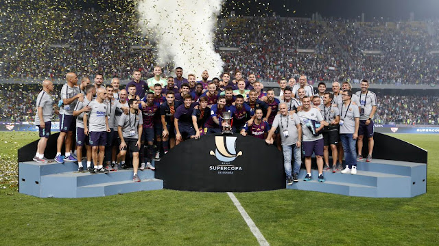 Barcelona players lifting the Spanish super cup after their 2-1 win against Sevilla