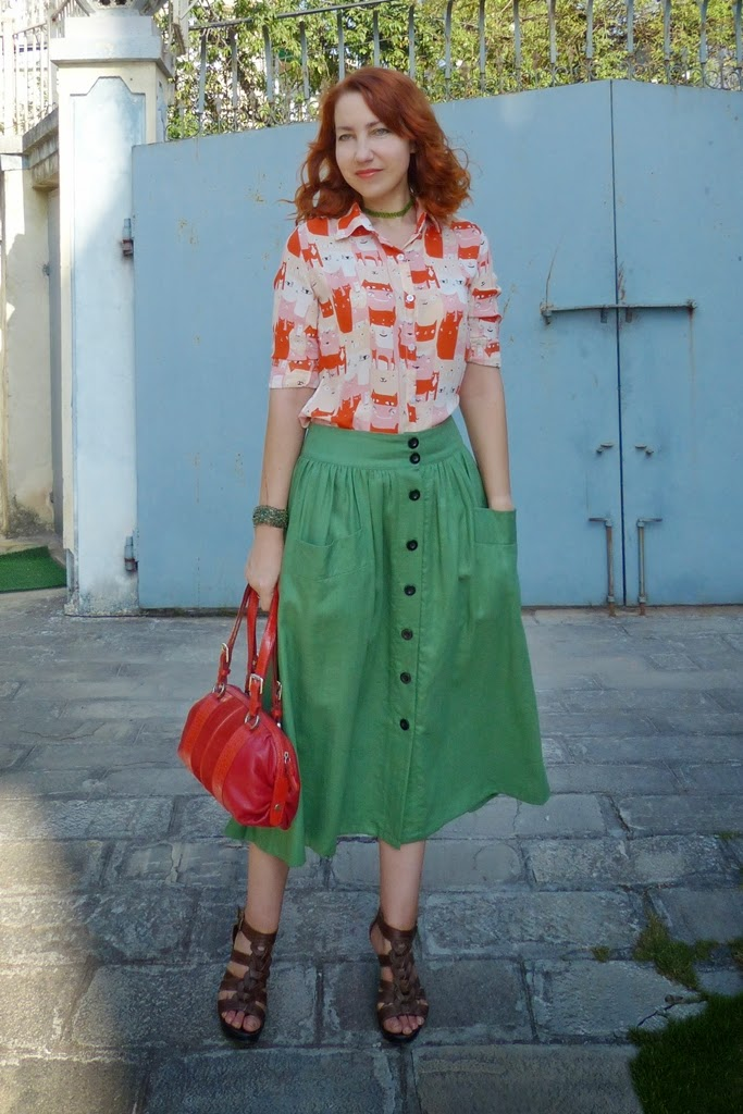Cat blouse and green button down skirt