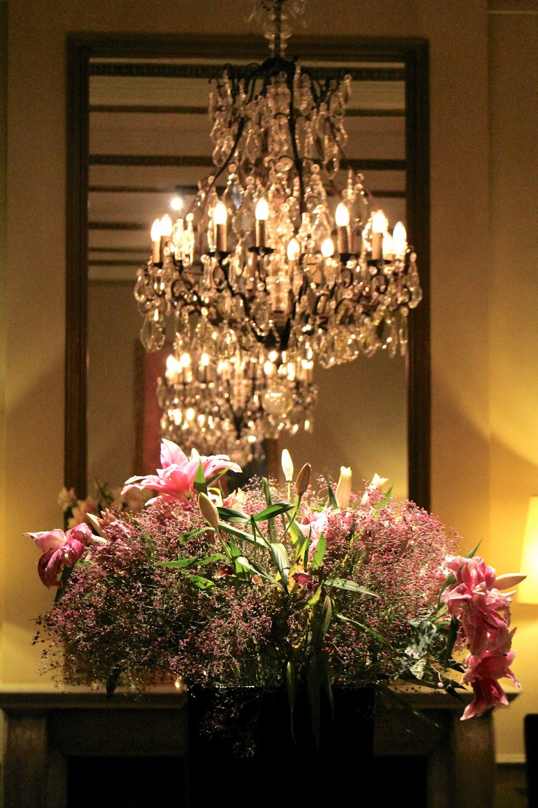 Luxurious hotel chandelier and flowers