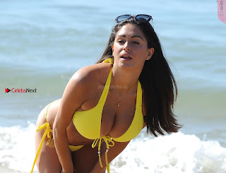 Casey Batchelor exposing her tits Cleavages and Lovely ass In Yellow Bikini on Beach in Portugal HD Pics