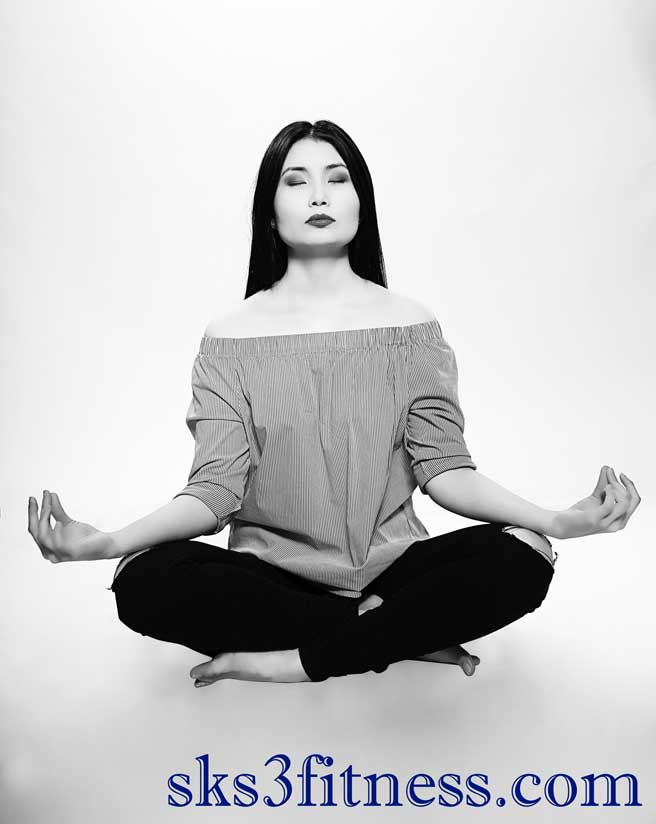 Girl doing meditation in Prithvi Mudra