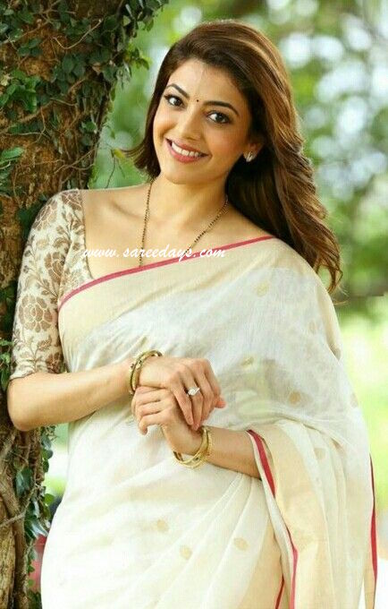 Latest saree designs kajal agarwal in off white lenin saree checkout kajal agarwal in off white lenin saree with zari work and paired with gold printed half sleeves blouse altavistaventures Image collections