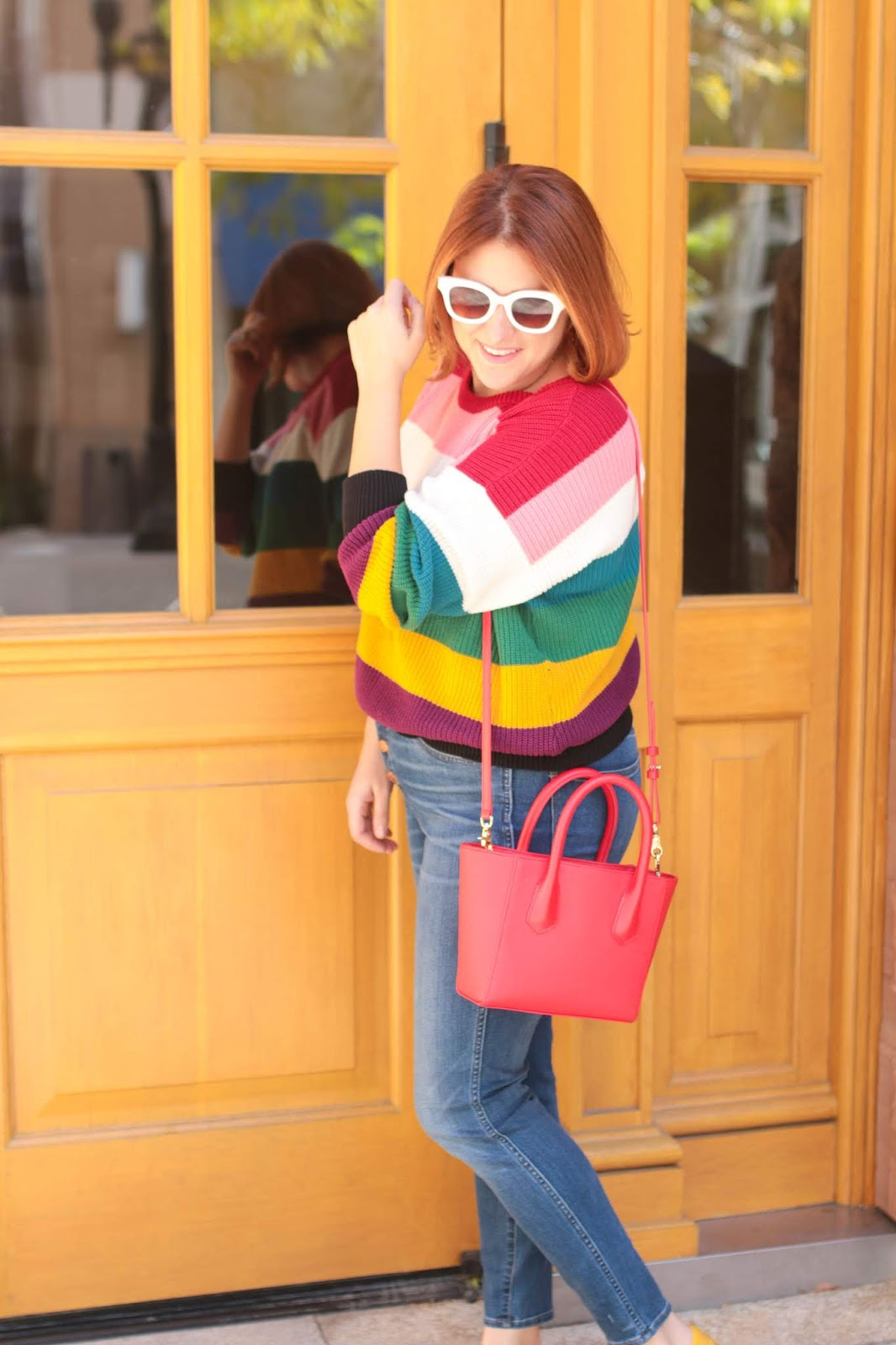 Rainbow stripe sweater, red hair, poppy petite tote Dagne Dover, madewell jeans, crosby coach driving moccasins