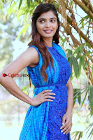 Tamil Actress Sanchita Shetty Latest Pos in Blue Dress at Yenda Thalaiyila Yenna Vekkala Audio Launch  0008.jpg