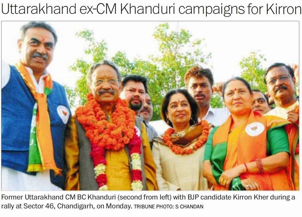 Former Uttarakhand CM BC Khanduri with BJP candidate Kirron Kher & Ex-MP Satya Pal Jain during a rally at Sector 46, Chandigarh, on Monday. Tribune Photo. S Chandan