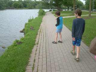 The boys looking at ducks on the bank of the Avon River.