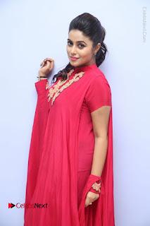 Actress Poorna Latest Stills in Red Dress at Rakshasi First Look Launch  0144.JPG