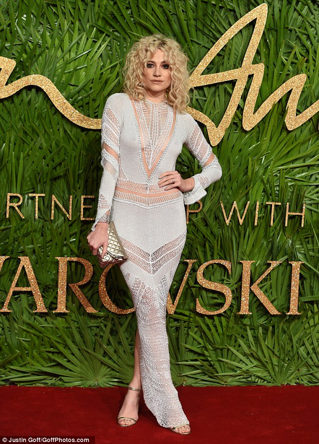 Pixie Lott attends the 2017 Fashion Awards in sheer crochet dress
