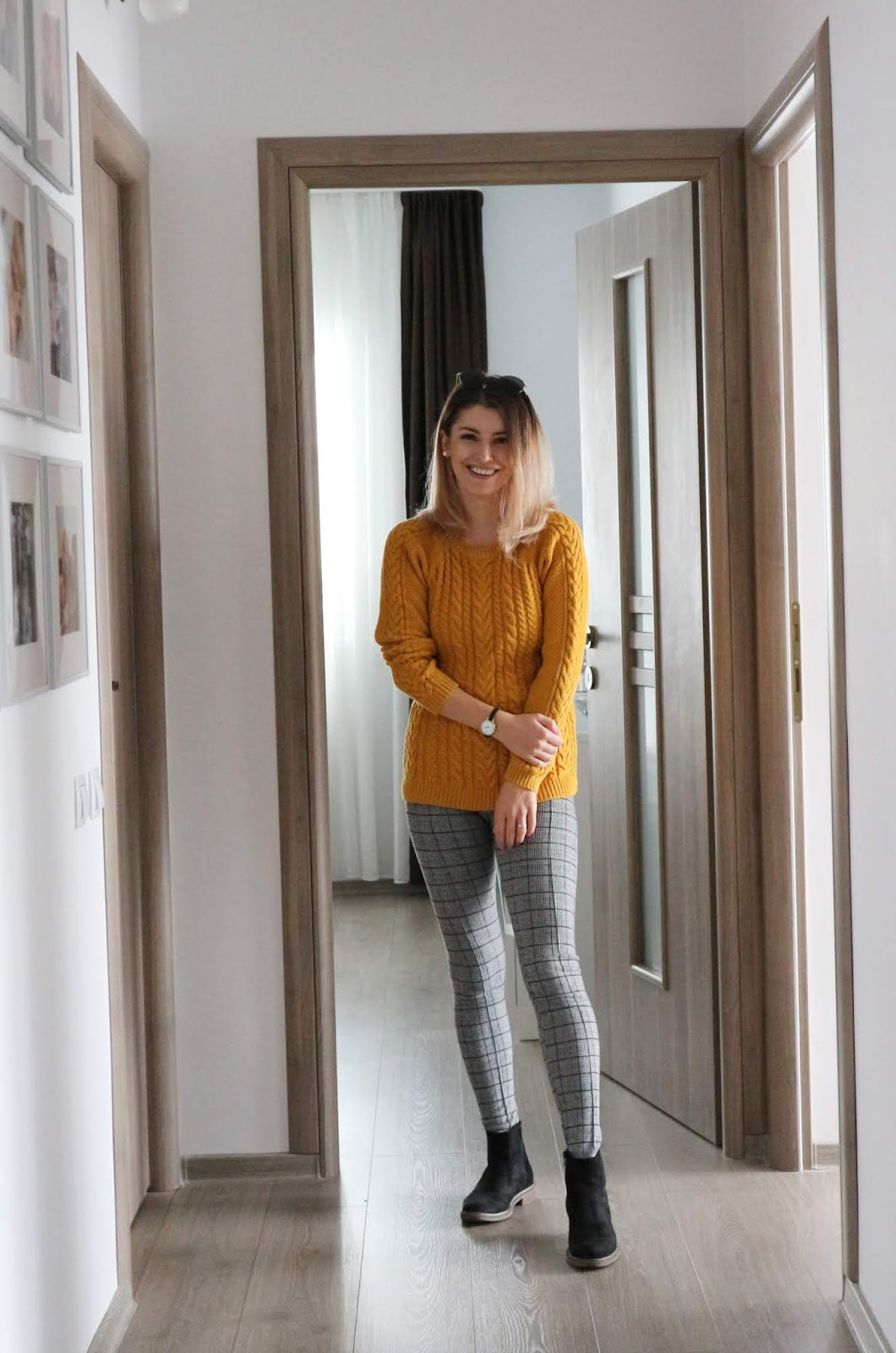 mustard sweater and grey checked leggings