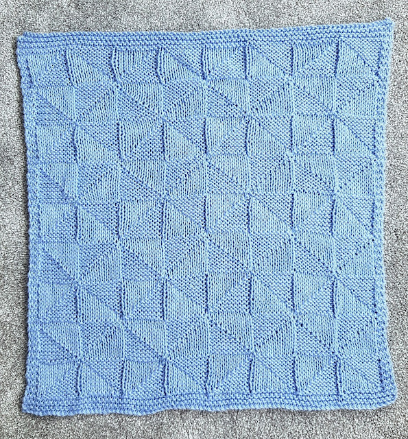 Check out this cute and easy geometric knitted baby blanket