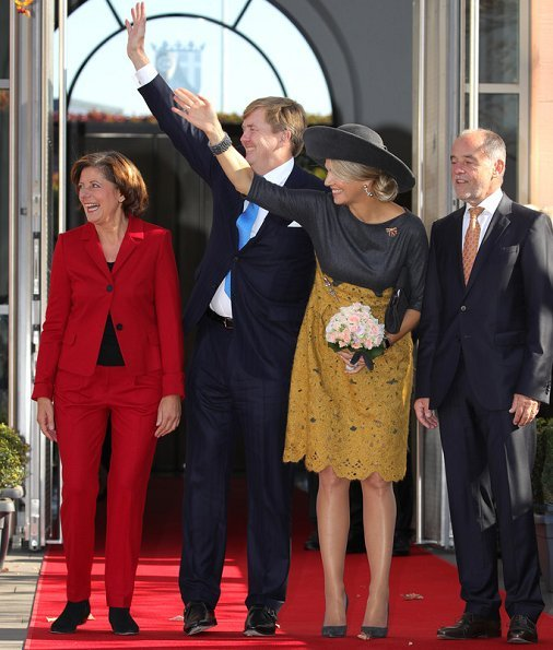 Governor of Rhineland-Palatinate Malu Dreyer and her Husband Klaus Jensen. Queen Maxima wore Natan wool top and yellow lace skirt. visit Germany