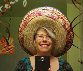 Denise wearing a sombrero.