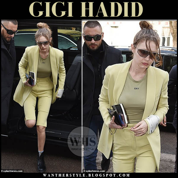 Gigi Hadid in lime green jacket and matching tailored shorts with black combat boots. Street style fashion week model outfits february 2019