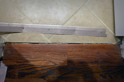 threshold metal strip tile wood floor hardwood