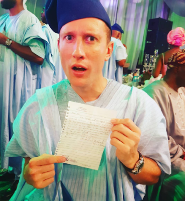 White guy in shock after receiving financial request note from a Nigerian at wedding reception
