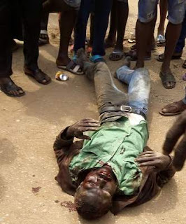 Jungle Justice Angry mob lynch suspected armed robber in