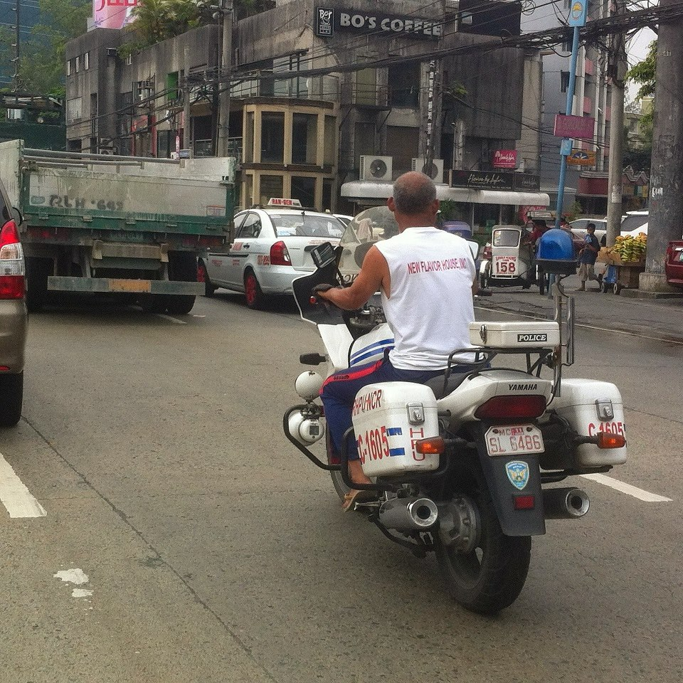 Filipino Motorcycle Police Officer Rides Around In Sando