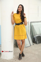 Actress Poojitha Stills in Yellow Short Dress at Darshakudu Movie Teaser Launch .COM 0147.JPG