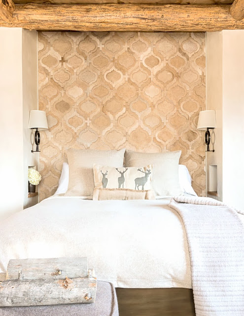 Chic cabin bedroom with a hide rug headboard