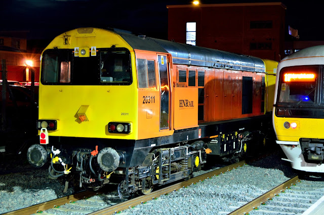 Night Photo of HN Rail Class 20311 Diesel Locomotive standing at Banbury railway station while on a service delivering new London Underground rolling stock