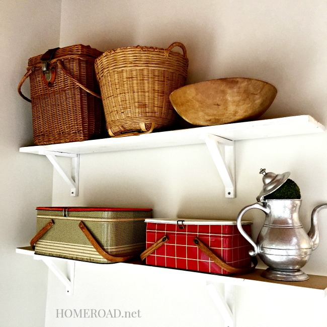 Baskets and lunchbox collection on shelves