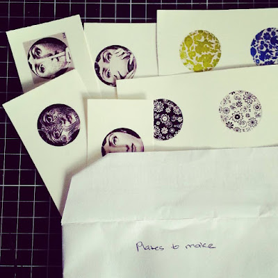 Several sheets of miniature printed plates in an envelope with the instructions 'plates to make' written on it.