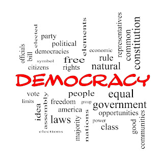 Word cloud with Democracy at centre and other related words crossword-style