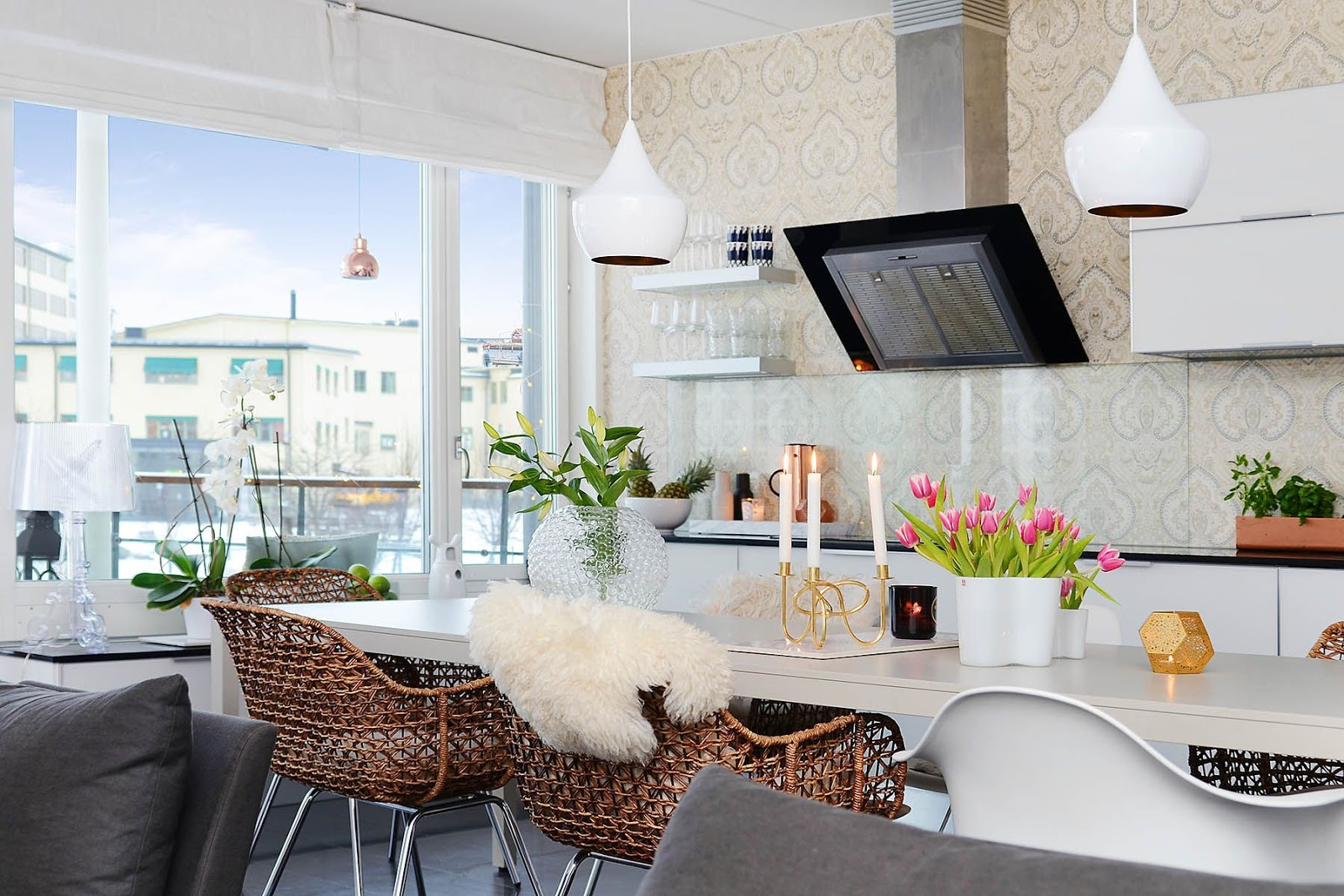luxe dining room with woven basket bar seats