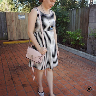awayfromtheblue instagram | black and white print mixing fit and flare dress leopard flats outfit with pastel pink darren bag