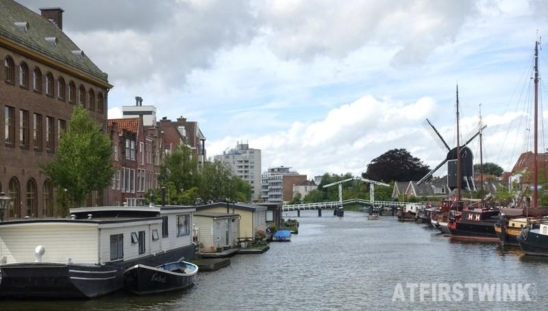 Molen de Put dutch windmill Leiden Netherlands bridge house boats
