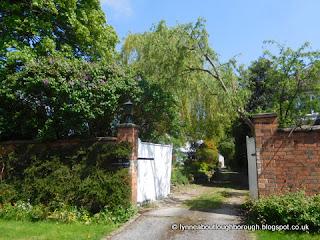 White gate on house driveway