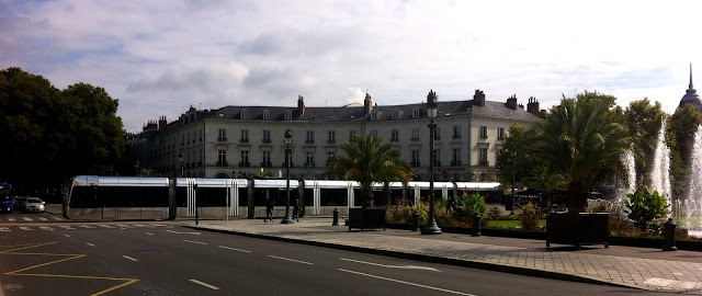 tram driving through Place Jean Jaures in Tours France