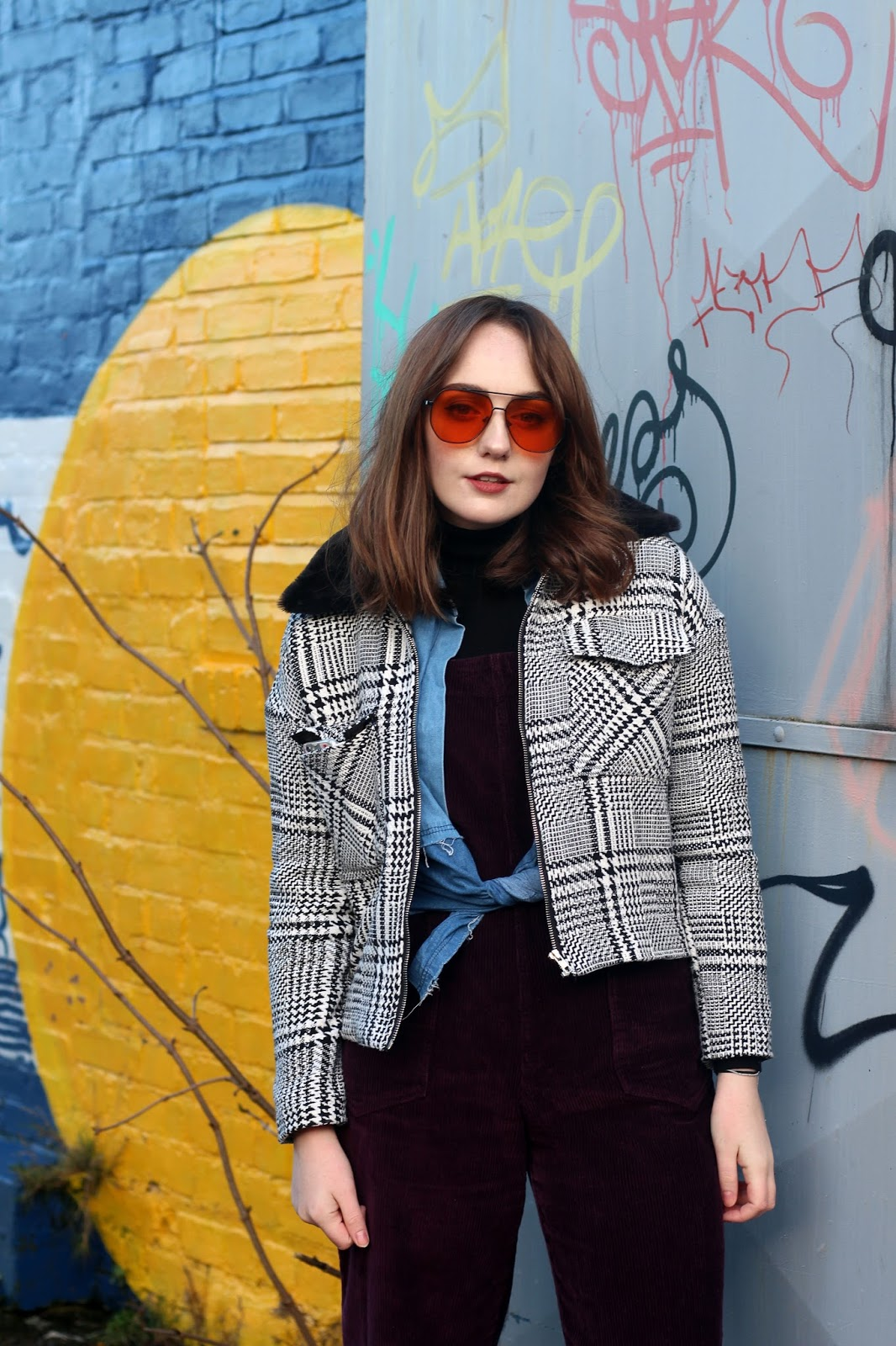 corduroy dungarees, denim shirt tied at waist, black and white checked jacket with black faux fur collar, orange tint aviator ASOS sunglasses