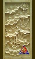 relief batu alam paras jogja/ paras putih motif bunga lotus