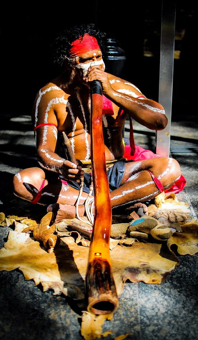 Australian Aboriginal with his wind instrument 10 Most Beautiful Island Countries in the World