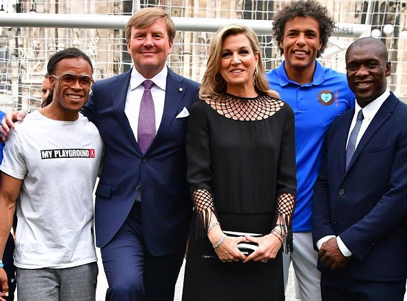 Queen Maxima and King Willem-Alexander attended a Football Clinic. Queen Maxima wore black long dress in Milan
