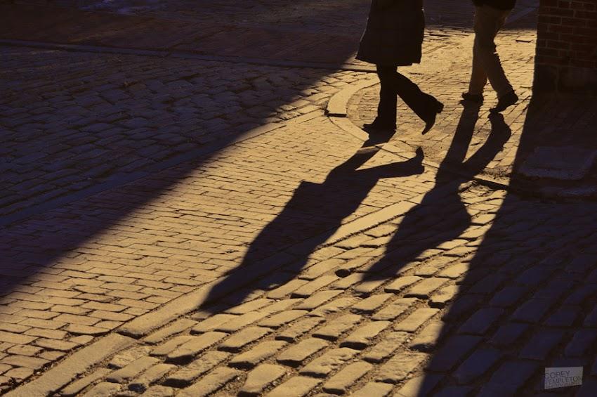 Portland, Maine USA photo by Corey Templeton. Thursday throwback: A pair of shadows on the cobblestones of Wharf Street. Taken January 29, 2012.