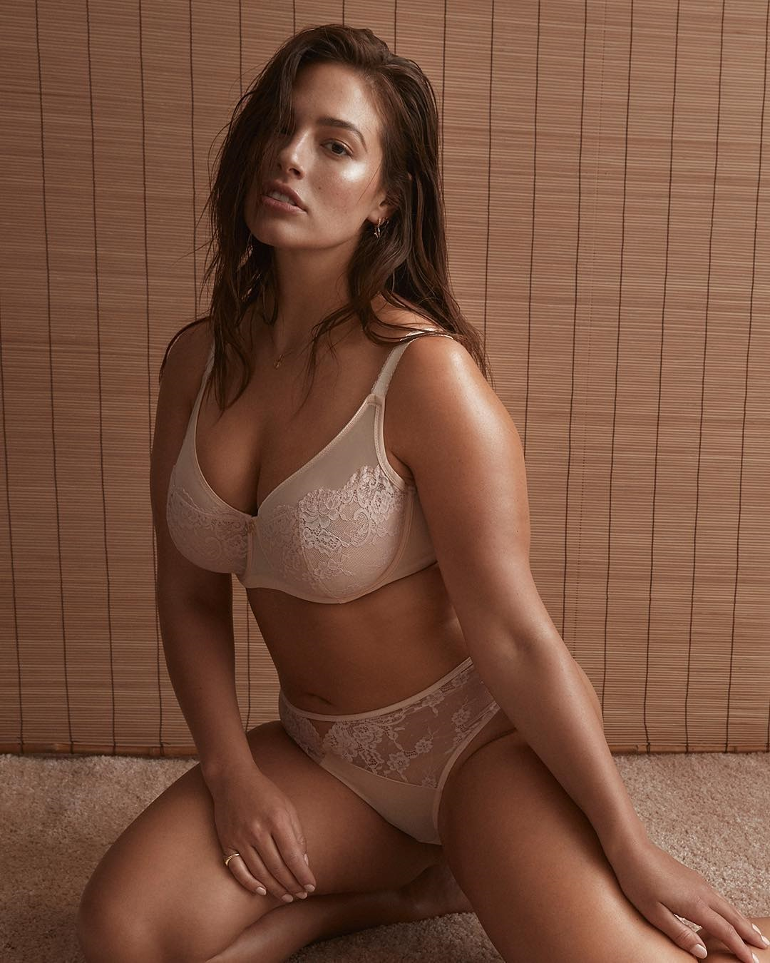 Ashley Graham proves her bombshell status as she models her own lingerie line in makeup-free photo