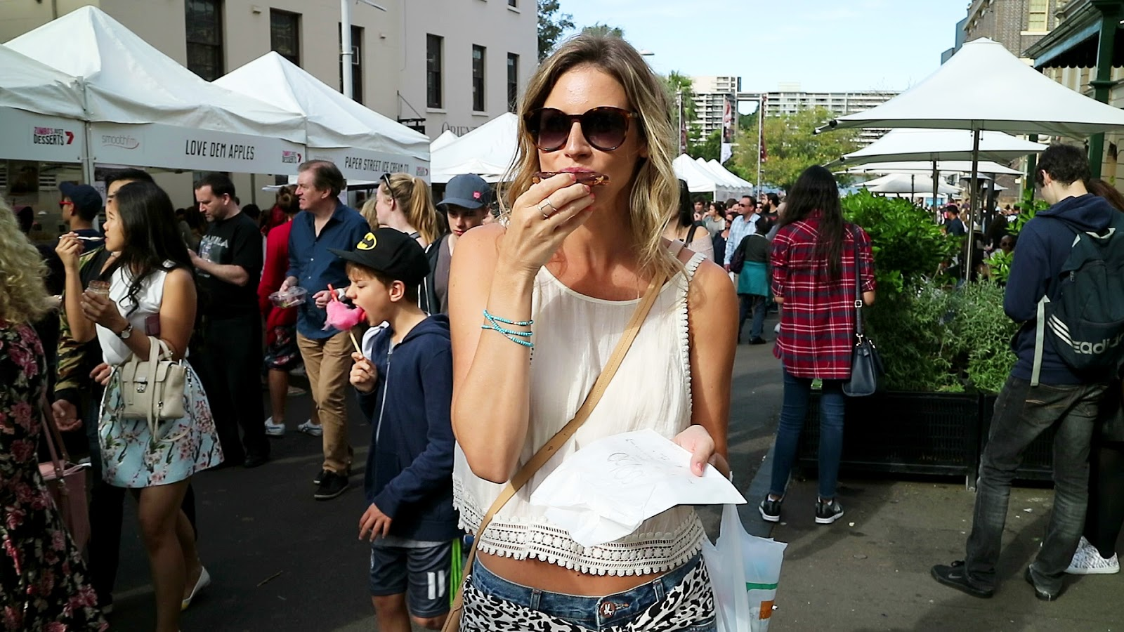 Travel blogger and digital nomad, Alison Hutchinson, enjoying a vegan snickers square at the Sydney Chocolate festival