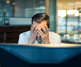 Man suffering from headache at work