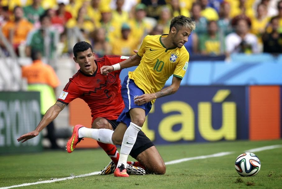 Brazil's Neymar (10) gets away from Mexico's Francisco Rodriguez during the group A World Cup soccer match between Brazil and Mexico at the Arena Castelao in Fortaleza, Brazil, Tuesday, June 17, 2014.