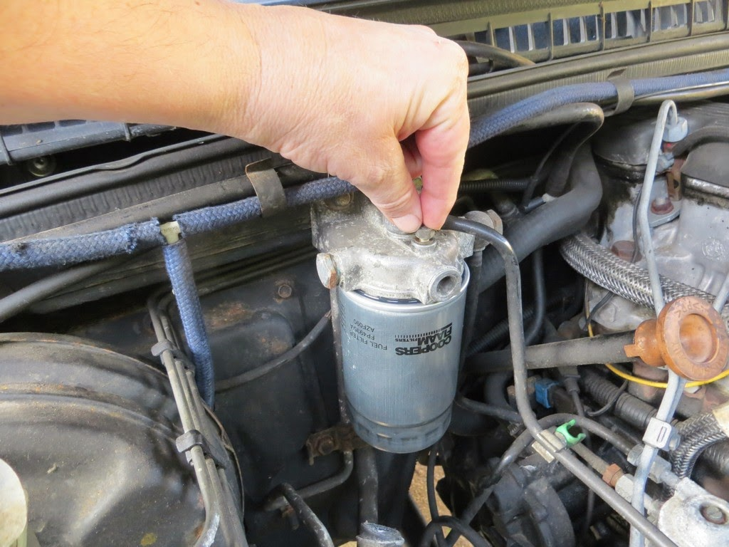 medium resolution of remove the fuel filter holder top screw