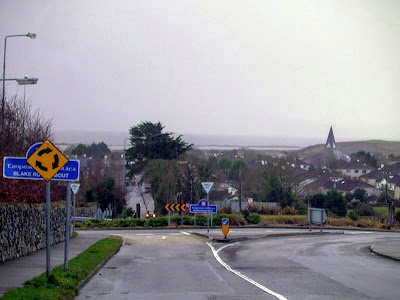 View of suburban Knocknacarra, showing the Blake Roundabout, Knocknacarra Church AKA Casey's last erection, and Galway Bay