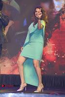 Actress Isha Koppikar Pos in Green Dress at Keshava Telugu Movie Audio Launch .COM 0047.jpg
