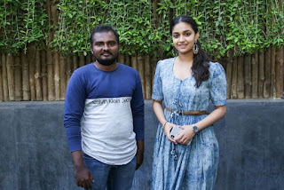 Keerthy Suresh in Blue Dress with Cute and Lovely Smile with a Fan 5