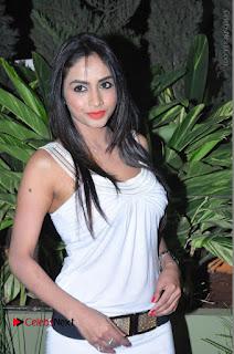 Actress Model Pooja Sri Stills in White Short Dress at F Club pre soft Launch  0036.JPG