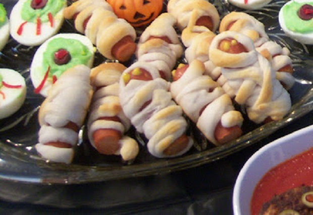 these are mummy's made out of refrigerated dough and hotdogs with deviled eggs to look like eyeballs
