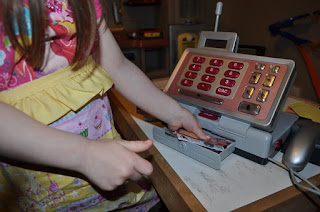 Learn through play with your kids by using a pretend cashier center
