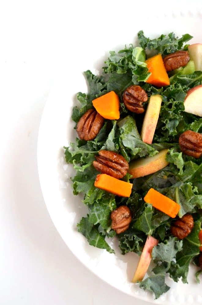 Kale Salad with Spicy Pecans, Apples and Butternut Squash is the perfect fall salad that is topped with an apple cider vinaigrette!  www.nutritionistreviews.com