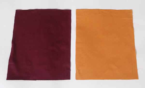 red piece of fabric, orange piece of fabric, fabrics, cotton fabrics